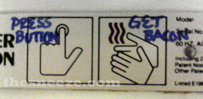 graffiti on a graphic describing how to use a hot-air hand dryer: press button, get bacon.